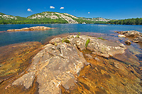 Precambrian Shield rock and Killarney Lake and the La Cloche Hills<br />