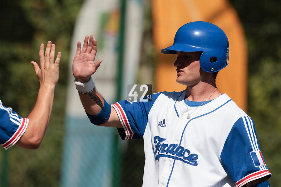 18 July 2010: Joris Bert of Team France is congratulated by a teammate during day 6 of the Open de Rouen, an international tournament with Team France, Team Saint Martin, Team All Star Elite, at Stade Pierre Rolland, in Rouen, France.