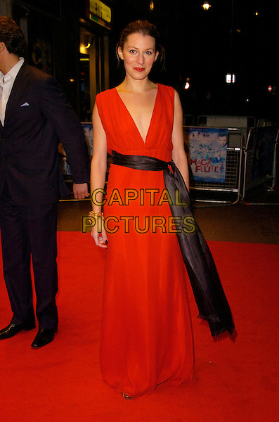 "AMY CARSON.UK Film Premiere of ""The Magic Flute"", Odeon West End,.London, England, November 26th 2007..full length red dress black sash belt.CAP/CAN .©Can Nguyen/Capital Pictures"