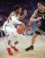 Arkansas guard Jimmy Whitt Jr. (left) looks to drive Wednesday, Jan. 15, 2020, as he is pressured by Vanderbilt forward Dylan Disu (1) during the first half in Bud Walton Arena. Check out nwaonline.com/photos for a gallery from the game. (NWA Democrat-Gazette/Andy Shupe)