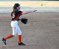 Westside Eagle Observer/MIKE ECKELS<br /> <br /> After picking up a ground ball to left field, Shylee Morrison (5) delivesr a throw to first base for a possible out during the Gravette-Rogers Heritage softball game at Lions softball field Friday night.