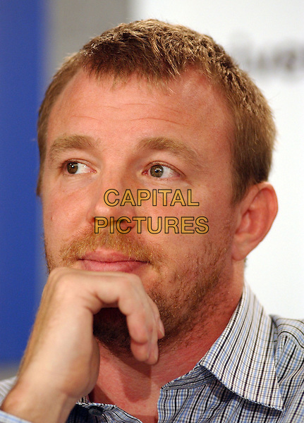 GUY RITCHIE.2005 Toronto Film Festival, Toronto, Ontario.September 11th, 2005.Photo Credit: George Shepherd/AdMedia.headshot portrait stubble facial hair hand.www.capitalpictures.com.sales@capitalpictures.com.© Capital Pictures.