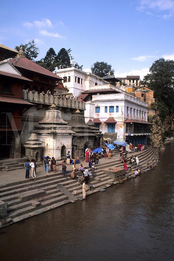 People worshiping and washing in the holy Baymati River in Kathmandu Nepal Katmandu