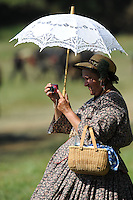 NWA Democrat-Gazette/ANDY SHUPE<br /> Ginger Johnson of Oak Grove, Mo., takes a photograph from the edge of the battlefield Saturday, Sept. 26, 2015, during a re-enactment of the Civil War Battle of Pea Ridge in Pea Ridge. Visit nwadg.com/photos to see more photos from the weekend.
