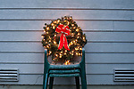 Christmas Wreath with Red Bow lit on Lawn Chair
