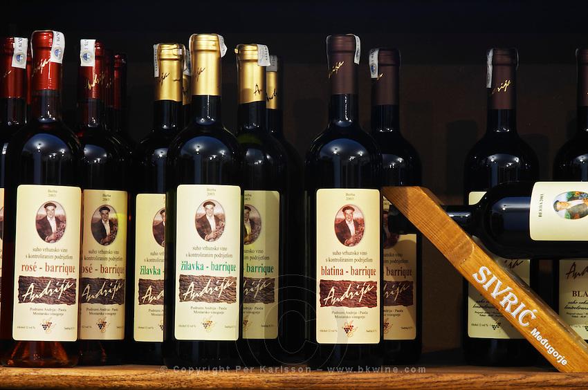 In the winery wine shop, display of various wines from the Podrum Andrija winery: rose barrique oak aged, Zilavka barrique, Blatina barrique. Podrum Vinoteka Sivric winery, Citluk, near Mostar. Federation Bosne i Hercegovine. Bosnia Herzegovina, Europe.