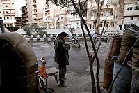 Syria, Deir az-Zor, 2013/03/19..A FSA fighter at Ganamat bridge checkpoint during his evening prayer. .Syrie, Deir ez-Zor, 19/03/2013.Un combattant des FSA au check point du pont Ganamat faisant sa prière du soir..Photo: Timo Vogt / Est&Ost Photography.