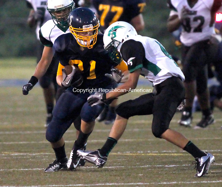 Waterbury, CT-07 September 2012-090712CM13-  Kennedy's Nate Andrews carries the ball during against Wilby during the second quarter at the City Jamboree Friday night at Municipal Stadium in Waterbury.  Wilby won the quarter and would later defeat Sacred Heart for the Jamboree Championship.      Christopher Massa Republican-American