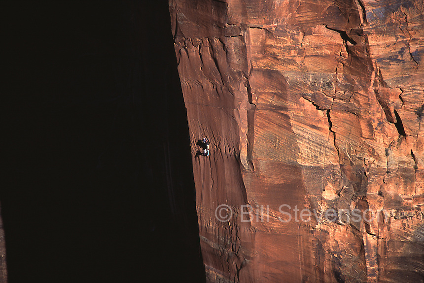 A group rock climbing The Shield in Zion National Park, UT.