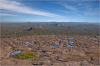 After recent rains, puddles form on the top of Enchanted Rock and provide an interesting foreground for picture-taking.