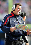 1 November 2009: Houston Texans' Head Coach Gary Kubiak discusses a play via headset during a game against the Buffalo Bills at Ralph Wilson Stadium in Orchard Park, New York, USA. The Texans defeated the Bills 31-10. Mandatory Credit: Ed Wolfstein Photo