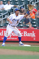 Cheslor Cuthbert #24 of the Omaha Storm Chasers gathers in a throw at first base against the Las Vegas 51s at Werner Park on August 17, 2014 in Omaha, Nebraska. The Storm Chasers  won 4-0.   (Dennis Hubbard/Four Seam Images)