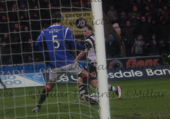 Sasa Papac makes a clearance nearly on the goal line to deny Paul McGowan in the St Mirren v Rangers Clydesdale Bank Scottish Premier League match played at St Mirren Park, Paisley on 24.12.11.