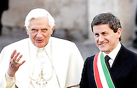 Papa Benedetto XVI  arriva in Campidoglio, Roma, 9 marzo 2009, accolto dal sindaco Gianni Alemanno, a destra..Pope Benedict XVI is welcomed by Rome's Mayor Gianni Alemanno, right, as he arrives at the Campidoglio City Hall in Rome, 9 march 2009..UPDATE IMAGES PRESS/Riccardo De Luca