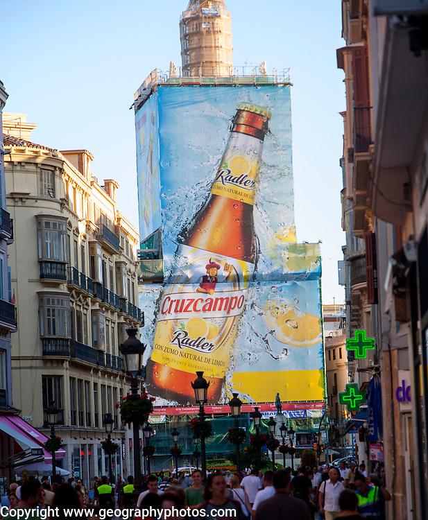 Street Calle Marques de Larios, city centre Malaga, Spain billboard Radler Cruzcampo beer advert