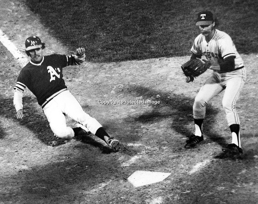 Oakland A's Ted Kubiak slides safely into home against the Texas Rangers. (photo/Ron Riesterer)