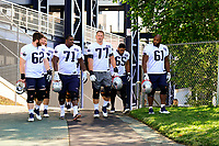 July 28, 2017: New England Patriots tackle Nate Solder (77)  walks to the practice fields with guard Joe Thuney (62), offensive lineman Cameron Fleming (71), offensive lineman Jamil Douglas (65) and offensive lineman Marcus Cannon (61) for the New England Patriots training camp held at Gillette Stadium, in Foxborough, Massachusetts. Eric Canha/CSM