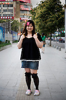 Xuhuizi, an editor, age 27, poses for a portrait in Nanjing. Response to 'What does China mean to you?': 'Home.'  Response to 'What is your role in China's future?': 'To construct the future.'
