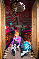 Skier arrives at a yurt  in the Kyrgyzstan backcountry while on a ski touring trip
