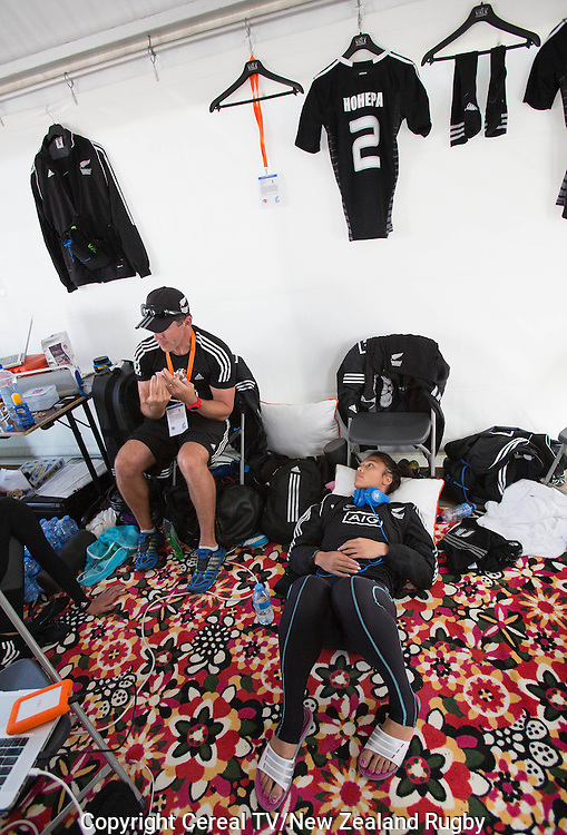 Coach Sean Horan (L) and Carla Hohepa in the team tent. IRB Women's Sevens World Series. Amsterdam, Netherlands, Friday 16 May 2014.