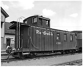D&amp;RGW long caboose #0505 in Durango with station in background<br /> D&amp;RGW  Durango, CO  Taken by Payne, Andy M. - 7/3/1966