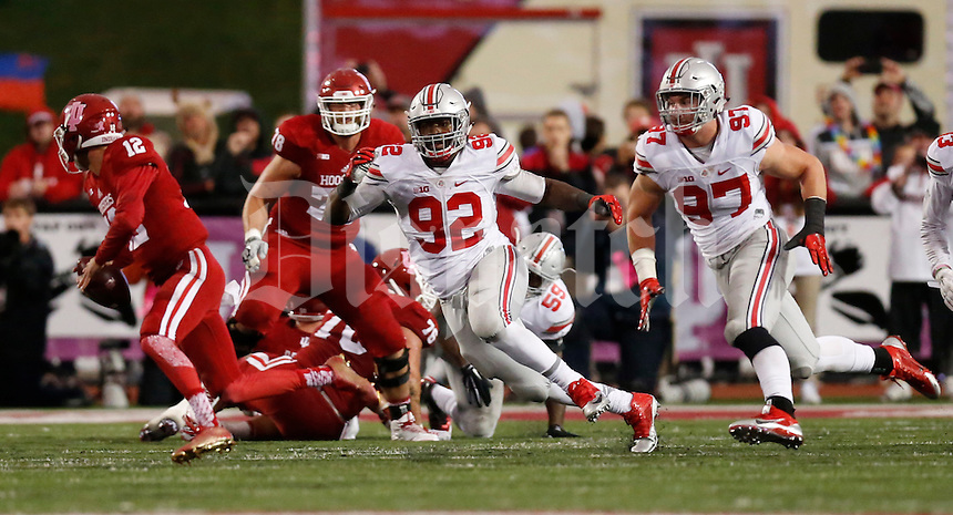 Indiana Hoosiers quarterback Zander Diamont (12) scrambles from Ohio State Buckeyes defensive lineman Adolphus Washington (92) and Ohio State Buckeyes defensive lineman Joey Bosa (97) on the last play of the game during an NCAA football game between the Ohio State Buckeyes and the Indiana Hoosiers at Memorial Stadium in Bloomington, Indiana, on Saturday, October 3, 2015. (Columbus Dispatch photo by Fred Squillante)