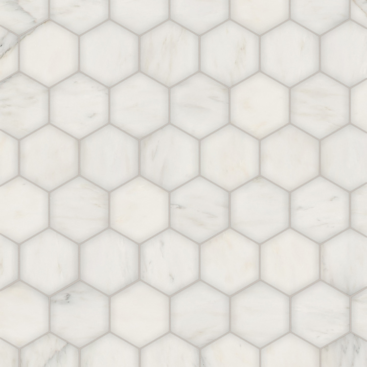Hex, a waterjet stone mosaic, shown in polished Calacatta Radiance, is part of the Semplice® collection for New Ravenna.