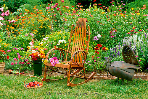 Grandmas chair and her best behaved garden turkey. A gaudy garden delight and summer floral explosion, midwest USA