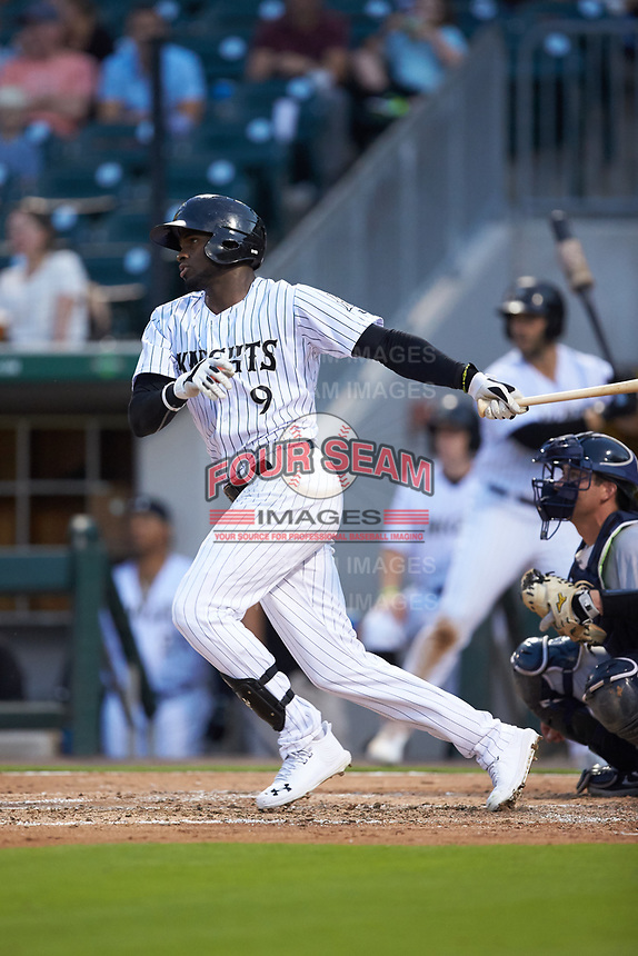 Luis Robert (9) of the Charlotte Knights follows through on his swing against the Scranton/Wilkes-Barre RailRiders at BB&T BallPark on August 13, 2019 in Charlotte, North Carolina. The Knights defeated the RailRiders 15-1. (Brian Westerholt/Four Seam Images)