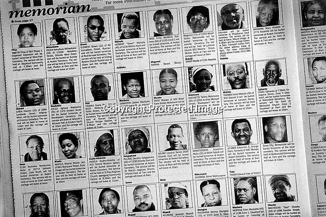 A Friday edition of Sowetan, the largest black newspaper in South Africa, where page after page of obituaries for diseased people are shown on May 2, 2003 in Soweto, South Africa. Many of these people are young and the country has seen a big increase in funerals since the HIV-Aids epidemic started in the country. The country has one of the highest aids infection rates in the world and its estimated that about one thousand people die each day. (Photo by: Per-Anders Pettersson).