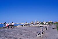 """L'Anse de l'Etang-du-Nord, Ile du Cap-aux-Meules, Iles de la Madeleine, Quebec, Canada - Family having a Picnic on Dock at """"Les Pecheurs"""" (The Fishermen) Sculpture (Artist: Roger Langevin) - (North Pond Cove, Grindstone Island, Magdalen Islands)"""