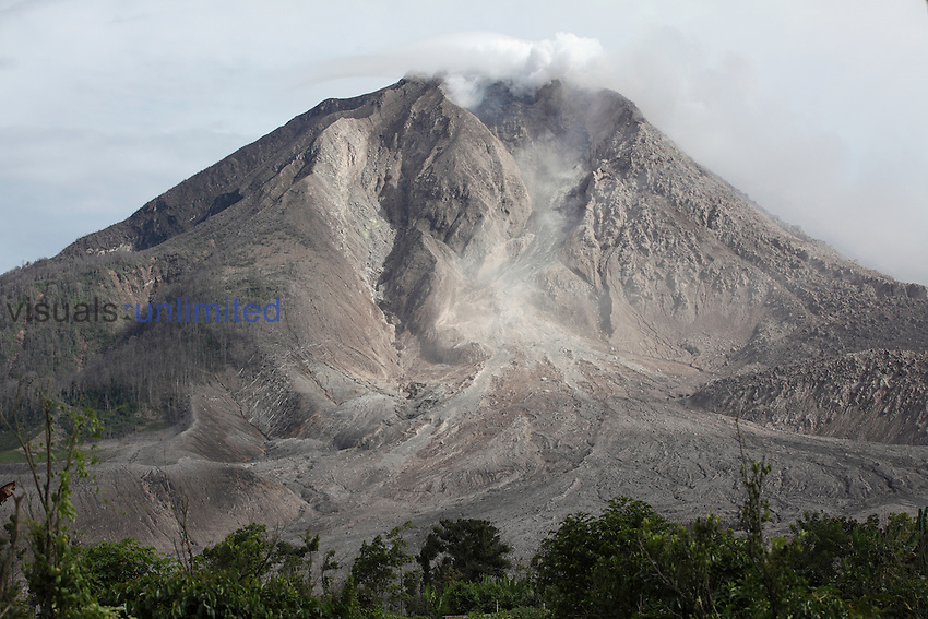 Sinabung Volcano with andesite lava dome at summit and lava flow deposit, Sumatra, Indonesia