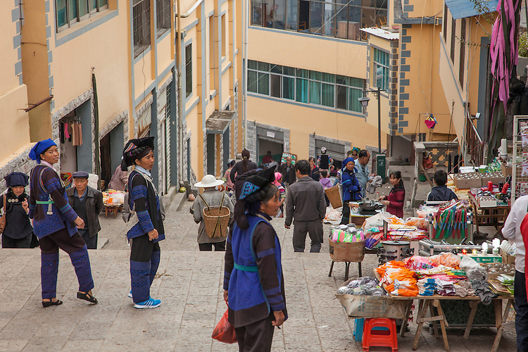 Market day in Xinjie near Yuanyang rice terraces brings out the Ye and Hani people in traditional dress.