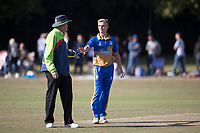 Pip George (umpire) hands the bowler his cap during Upminster CC vs Essex CCC, Benefit Match Cricket at Upminster Park on 8th September 2019