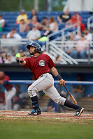Mahoning Valley Scrappers third baseman Jonathan Laureano (25) follows through on a swing during a game against the Batavia Muckdogs on August 18, 2017 at Dwyer Stadium in Batavia, New York.  Mahoning Valley defeated Batavia 8-2.  (Mike Janes/Four Seam Images)