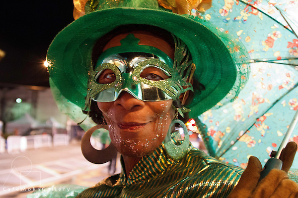 Traditional mas - Dames Lorraine Madame Big Shot in green  - Close up portrait with mask, hat and earrings Nelly Joseph