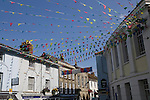 Bunting flags flying in street of town centre, Falmouth, Cornwall, England, UK