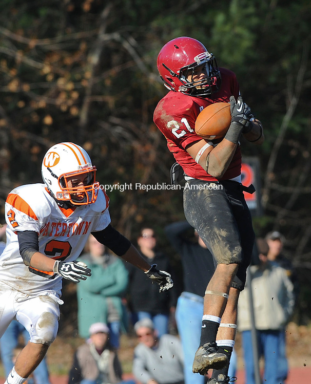 TORRINGTON, CT 22 NOVEMBER- 112212JS15- Torrington's Edgar Gonzalez (21) pulls in a reception in front of Watertown's Leonel Mideros (2) during their annual Thanksgiving Day game Thursday at Torrington High School. .Jim Shannon Republican American