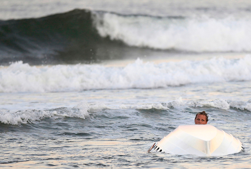 OCEAN GROVE, NJ - (July 29, 2013) - Spring Lake lifeguard emerges from beneath his capsized surfboat during the boat relay at the 45th Annual Ocean Grove Lifeguard Tournament Monday evening. Long Branch was the overall winner. Spring Lake finished last.