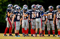 Youth sports photography of boys participating in the Cornelius, NC-based Lake Norman Giants football league, part of the Pop Warner Football and Cheer program. Pop Warner is a non-profit organization focused on teaching leadership, teamwork, discipline and football fundamentals. The Lake Norman Giants league offers five distinct play levels of tackle football. Divisions are determined by age and weight. Players in this series of photos are part of the Jr Midget division.
