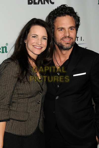 "KRISTIN DAVIS & MARK RUFFALO .Oxfam America and Esquire House LA Host ""The Oxfam Party"" held at Esquire House LA, Los Angeles, California, USA, .18th November 2010..half length black beard facial hair make-up brown grey gray jacket wool tweed beauty .CAP/ADM/BP.©Byron Purvis/AdMedia/Capital Pictures."
