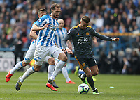 Leicester City's James Maddison shields the ball from Huddersfield Town's Jon Gorenc Stankovic <br /> <br /> Photographer Stephen White/CameraSport<br /> <br /> The Premier League - Huddersfield Town v Leicester City - Saturday 6th April 2019 - John Smith's Stadium - Huddersfield<br /> <br /> World Copyright © 2019 CameraSport. All rights reserved. 43 Linden Ave. Countesthorpe. Leicester. England. LE8 5PG - Tel: +44 (0) 116 277 4147 - admin@camerasport.com - www.camerasport.com