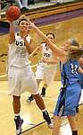 SIOUX FALLS, SD - DECEMBER 5:  Amber Paden #42 from the University of Sioux Falls shoots past Lauren Buck #22 from Upper Iowa in the second half of their game Friday night at the Stewart Center.  (Photo by Dave Eggen/inertia)