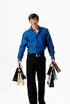 Young man walking, carrying shopping bags