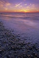 The sun sets on the Lake Erie shore at Geneva State Park, Ashtabula County, Ohio
