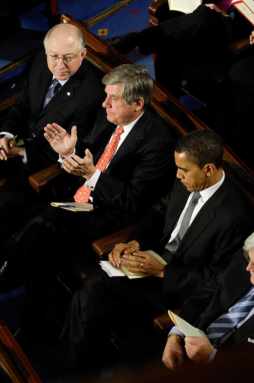 WASHINGTON, DC - Jan. 28: Sen. Ken Salazar (D-Colo.), Sen. Benjamin E. Nelson (D-Neb.) and Sen. Barack Obama (D-Ill.) listen as President George W. Bush delivers his final State of the Union address to a joint session of the U.S. Congress.  (Photo by Scott J. Ferrell/Congressional Quarterly)