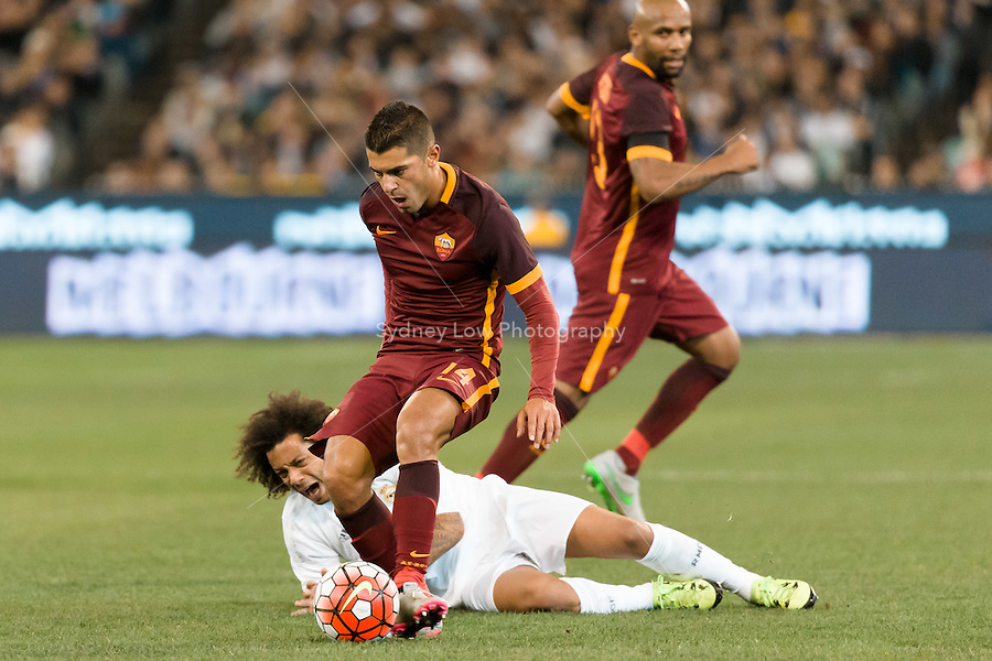 Melbourne, 18 July 2015 - Marcelo Vieira of Real Madrid is fouled by Iago Falque of AS Roma in game one of the International Champions Cup match at the Melbourne Cricket Ground, Australia. Roma def Real Madrid 7-6 Penalties. Photo Sydney Low/AsteriskImages.com