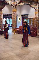 Bhutan, Paro. Dancers at Zhiwa Ling Hotel.