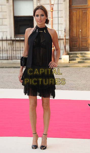Sasha Volkova.Arrivals at the Royal Academy Summer Exhibition 2012 - preview party held at the Royal Academy of Arts, London, England..May 30th, 2012.full length black sleeveless dress sheer lace see through thru bra blue hand on hip.CAP/WIZ.© Wizard/Capital Pictures.