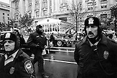 Washington DC, USA<br /> January 20, 2001<br /> <br /> Security circles US President George W Bush's motorcade as it passes through Freedom Square down Pennsylvania Avenue. Protesters line the route and demonstrate against his inauguration.